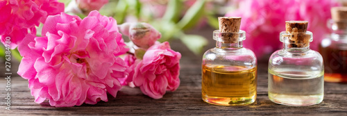 Obraz Panoramic header of essential oil bottles and roses - fototapety do salonu