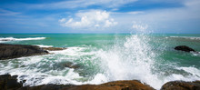 Relaxing Ocean Waves Crashing Into Rocky Shore On Sunny Summer.