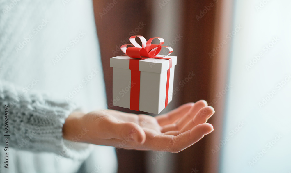 Fototapety, obrazy: Woman holding gift box with bow