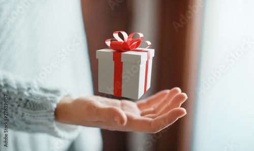 Woman holding gift box with bow