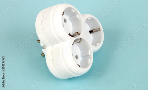 Isolated triple plug adapter on white background Wallpaper Mural