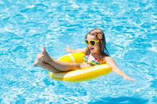 Child In Swimming Pool On Ring Toy. Kids Swim.
