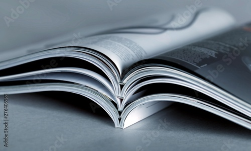 Obraz Pile of Open magazines, blue toned image - fototapety do salonu