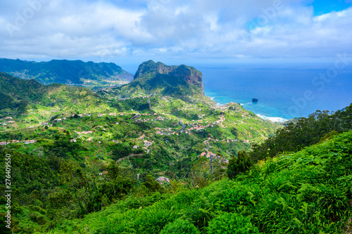 Poster Green Landscape scenery from Portela Viewpoint - Porto da Cruz at beautiful coast and mountains in the north of Madeira island - Ribeira Frio-Portela, Portugal.