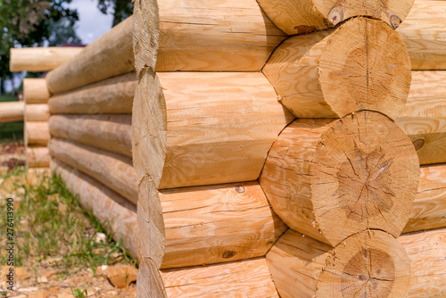 Construction of the wooden house from round logs Canvas Print