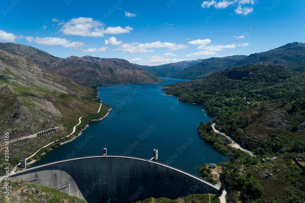 Aerial scenic view of the Vilarinho das Furnas Dam at the Peneda Geres National Park, in Portugal.