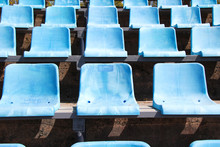 Old Blue Stadium Seats In A Row