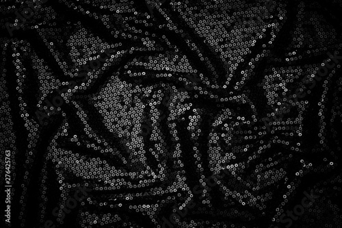 Photo  Metal glitter black cloth background, close up