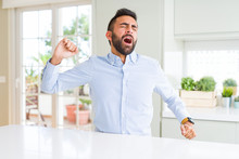 Handsome Hispanic Business Man Stretching Back, Tired And Relaxed, Sleepy And Yawning For Early Morning