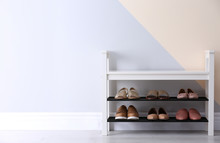 Shoe Rack With Different Footwear Near Color Wall, Space For Text. Stylish Hallway Interior