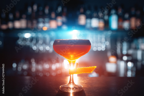 Cuadros en Lienzo  glass of fresh orange cocktail on blue background