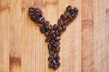 Alphabet Letter Y Made From Roasted Coffee Beans, 3D Rendering On Wooden Table Background