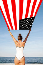 Beautiful Patriotic Woman Hold...