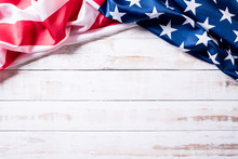 Top View Of Flag Of The United States Of America On White Wooden Background. Independence Day USA, Memorial.