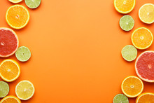 Many Different Citrus Fruits On Color Background