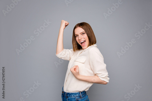 Photo  Portrait of cute charming positive cheerful lady raise fists scream shout yeah i