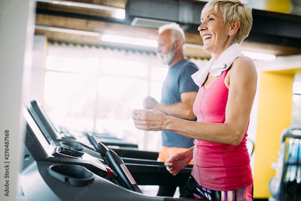 Fototapety, obrazy: Picture of senior people running on treadmill in gym