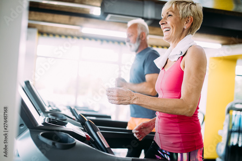 plakat Picture of senior people running on treadmill in gym