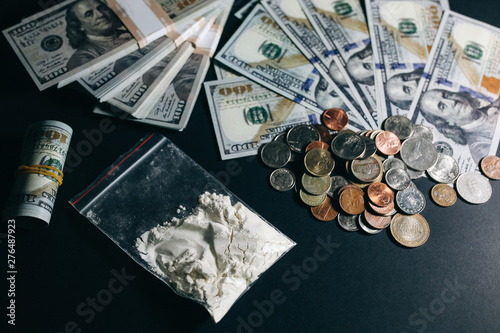 Fotografie, Tablou  Cocaine packet with dollar notes on the table