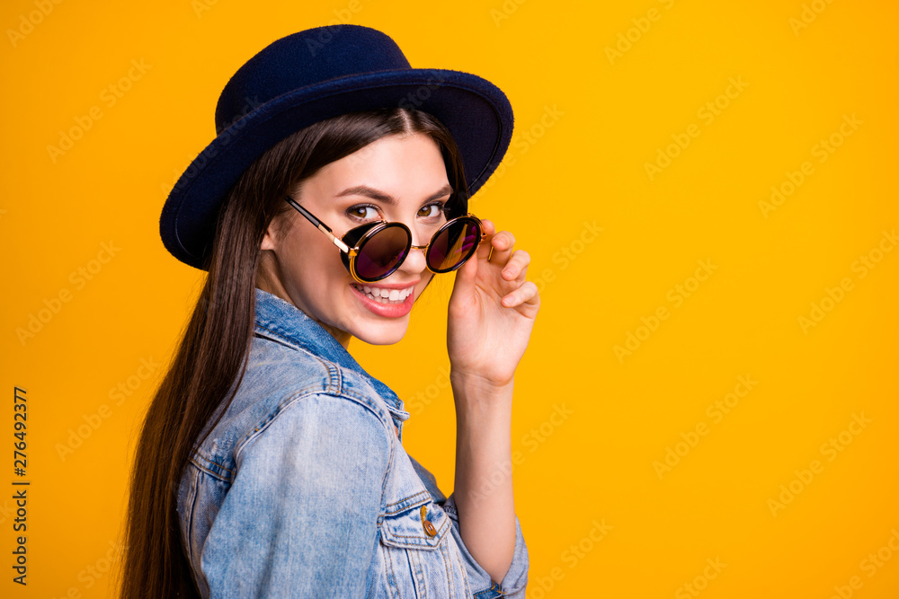 Fototapeta Close-up profile side view portrait of nice cute attractive lovely sweet adorable fascinating cheerful optimistic straight-haired lady touching glasses isolated on bright vivid shine yellow background