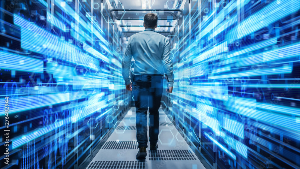 Fototapety, obrazy: Shot of a Young It Specialist Walking through Corridor in Working Data Center Full of Rack Servers and Supercomputers. Conceptual Visualisation of High Speed Internet Connection with Digits and Lines.