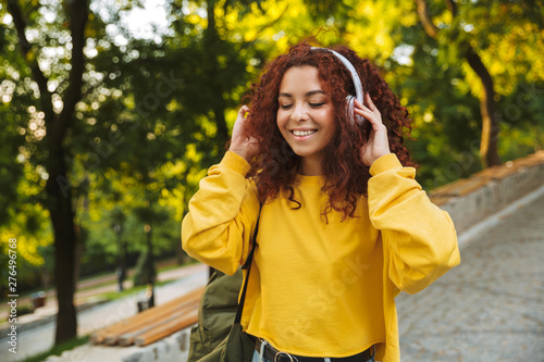 Deurstickers Graffiti collage Beautiful young cheerful girl spending good time