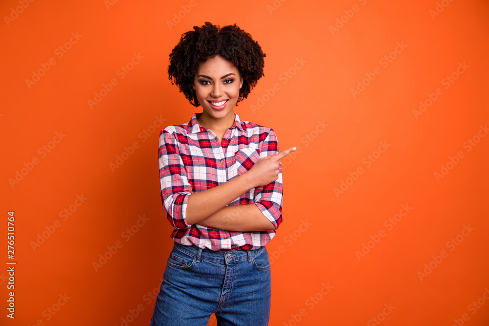 Fototapety, obrazy: Portrait of her she nice attractive lovely cheerful cheery confident wavy-haired lady wearing checked shirt pointing aside ad advert isolated on bright vivid shine orange background