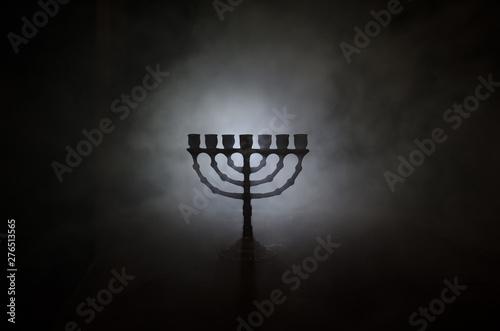 Low key image of jewish holiday Hanukkah background with menorah on dark toned f Wallpaper Mural