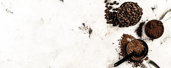 Coffee concept - beans, ground, instant, capsules marble background top view