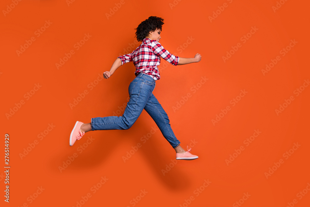Fototapety, obrazy: Full length side photo of jumping high athletic lady run shopping sale discount wear jeans denim pants plaid shirt outfit isolated orange background