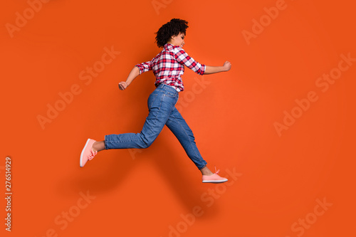 Full length side photo of jumping high athletic lady run shopping sale discount Canvas Print