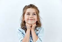 Dreamy,pleased, Thinking Emotion . Wish Concept. Little Child Girl Face Portrait On White Backgound.