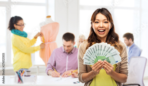 Fotomural  education, funding and fashion design, concept - happy asian young woman holding