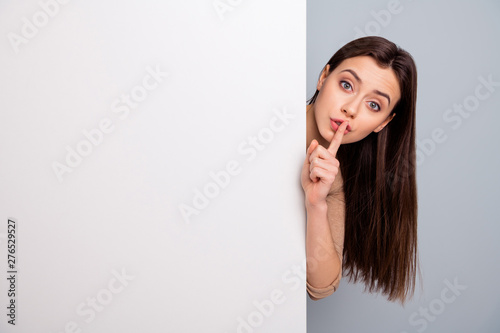 Fototapeta Close up photo of strict lady hide big billboard news text dont want share news charming gorgeous isolated wear stylish trendy shirt grey background obraz