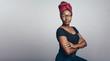 Leinwanddruck Bild - African woman in a headwrap