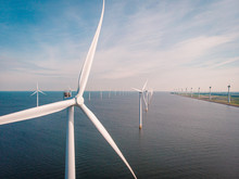 Windmill Farm Renewable Enrgy, Green Energy With Windmill Park In Ocean And Land