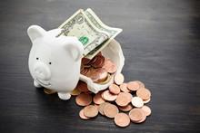 Broken Piggy Bank With Money O...