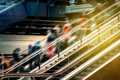 Fototapeta People on escalator inside  train station , travel concept blur -