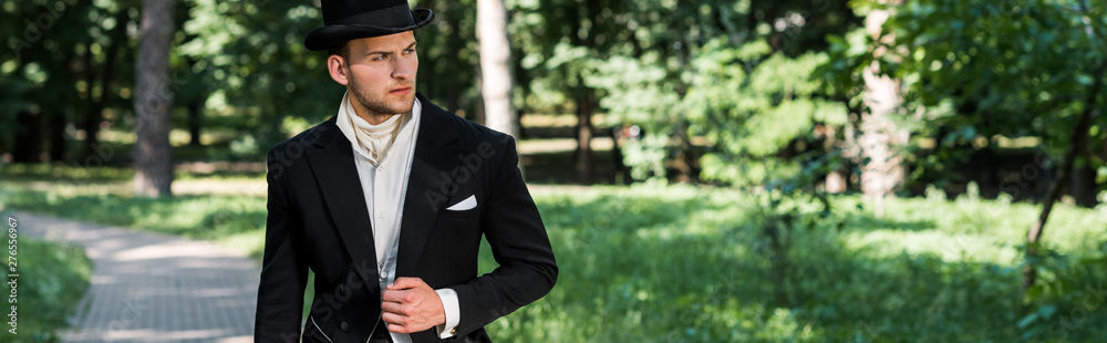 Fototapety, obrazy: panoramic shot of handsome victorian man in hat standing outside