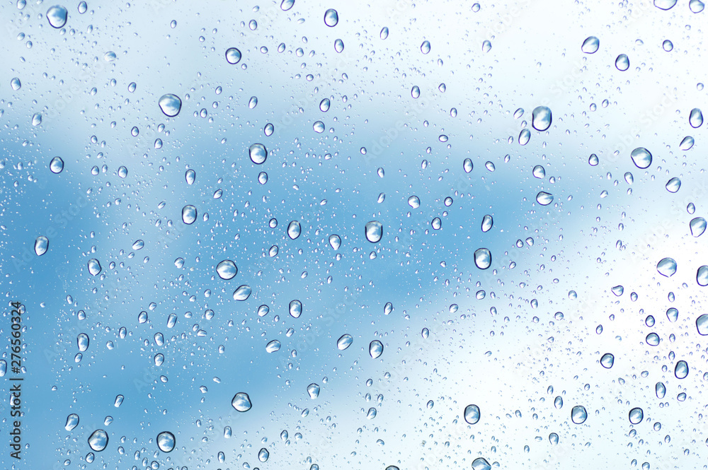 Fototapety, obrazy: Water drops of rain on blue glass background