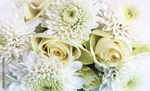 Canvas Prints Floral White flowers on white background. Wedding flowers. Flower arrangement. Pastel color. The view from the top. Background for greetings, wedding invitations, women's day and other holidays.