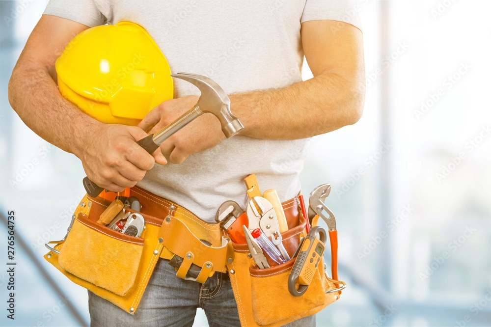 Fototapety, obrazy: Worker with a tool belt. Isolated over white background.