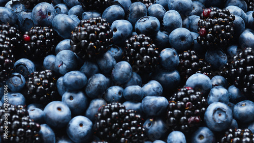 Valokuvatapetti Blackberry and  blueberry background. Top view.