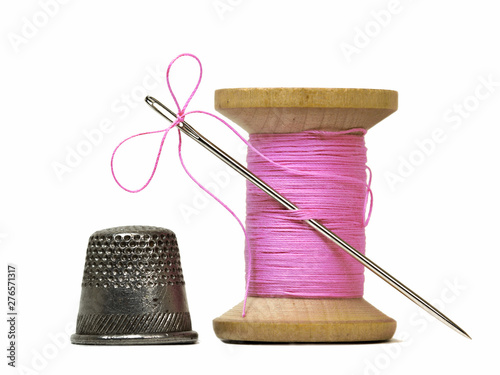 Canvas Print sewing threads spool with sewing needle and thimble isolated on