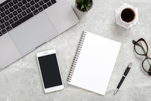 Flat Lay Office Desk. Female Workspace Laptop Computer, Blank Copy Space Mockup Screen Smartphone, Coffee Cup, Diary, Glasses. Succulent Plant On Concrete Stone Background. Top View Feminine Workspace