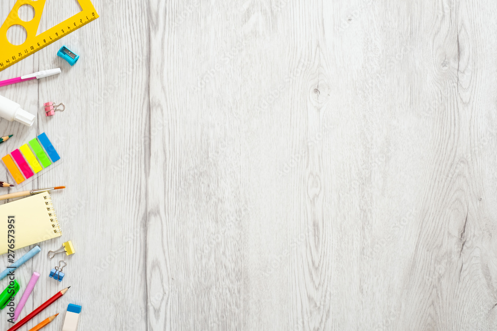 Fototapety, obrazy: Back to school concept, creative layout with with various stationery on wooden desk table. Flat lay style composition, top view, overhead.