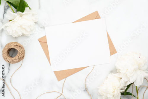 Top View Blank Wedding Invitation Card On Marble Background