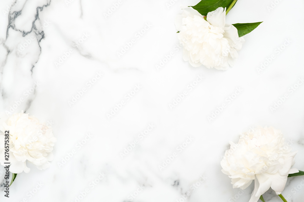 Fototapety, obrazy: Top view frame of white peony flowers on marble background. Minimal flat lay style home desk with peonies. Wedding invitation card mockup with copy space. Beauty or fashion blog banner template