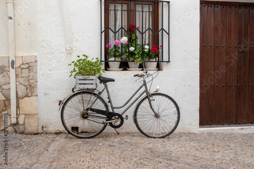 bicycle in front of old house
