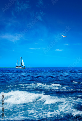 Seascape with sailboat on horizon over sunny blue sky Fototapeta